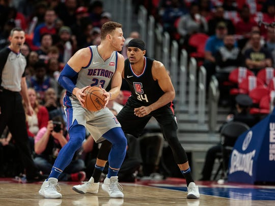Blake Griffin is defended by Tobias Harris at Little Caesars Arena in Detroit, Feb. 9, 2018.