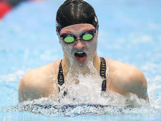 Yorktown's Emily Weiss finishes the 100 yard breaststroke