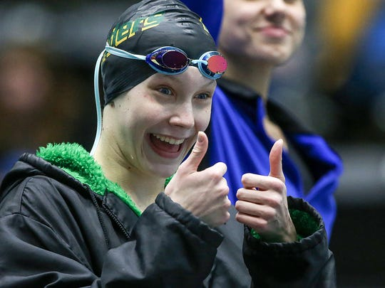 Northridge's Elsa Fretz holds two thumbs up after finishing