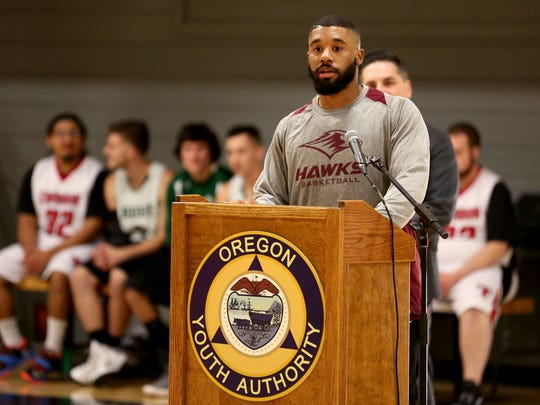 Chris, 24, an inmate at the MacLaren Youth Correctional Facility, speaks during a dedication of a new gym floor at MacLaren in Woodburn on Thursday, Feb. 8, 2018. Salem Evangelical Church donated $110,000 to replace the old concrete gym floor at the facility with a new wood floor.