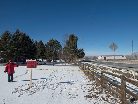 Yellow tape and a sign marking 84 feet from the road shows the extent that the proposed pipeline, that would carry millions of gallons of Poudre River water from reservoirs north of Fort Collins to the growing city of Thornton, might cut into longtime resident Yvonne Wittreich's property on Tuesday, Feb. 13, 2018, on the 1000 block of East Douglas Road in Fort Collins, Colo.