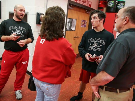 Coach Cale Hoover, senior wrestler Gleason Mappes and