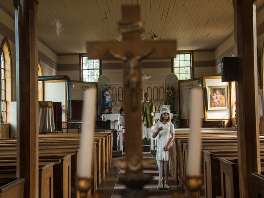 Mannequins are arranged inside the Church of the Assumption in Phoenix, a now-defunct mining town in Michigan's Keweenaw Peninsula, as seen on Aug. 21, 2017. The church was built in 1858.