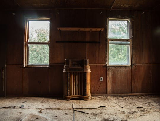 An antique cabinet radio stands inside the living room of an abandoned miner's shack in the Upper Peninsula ghost town of Central, Michigan.