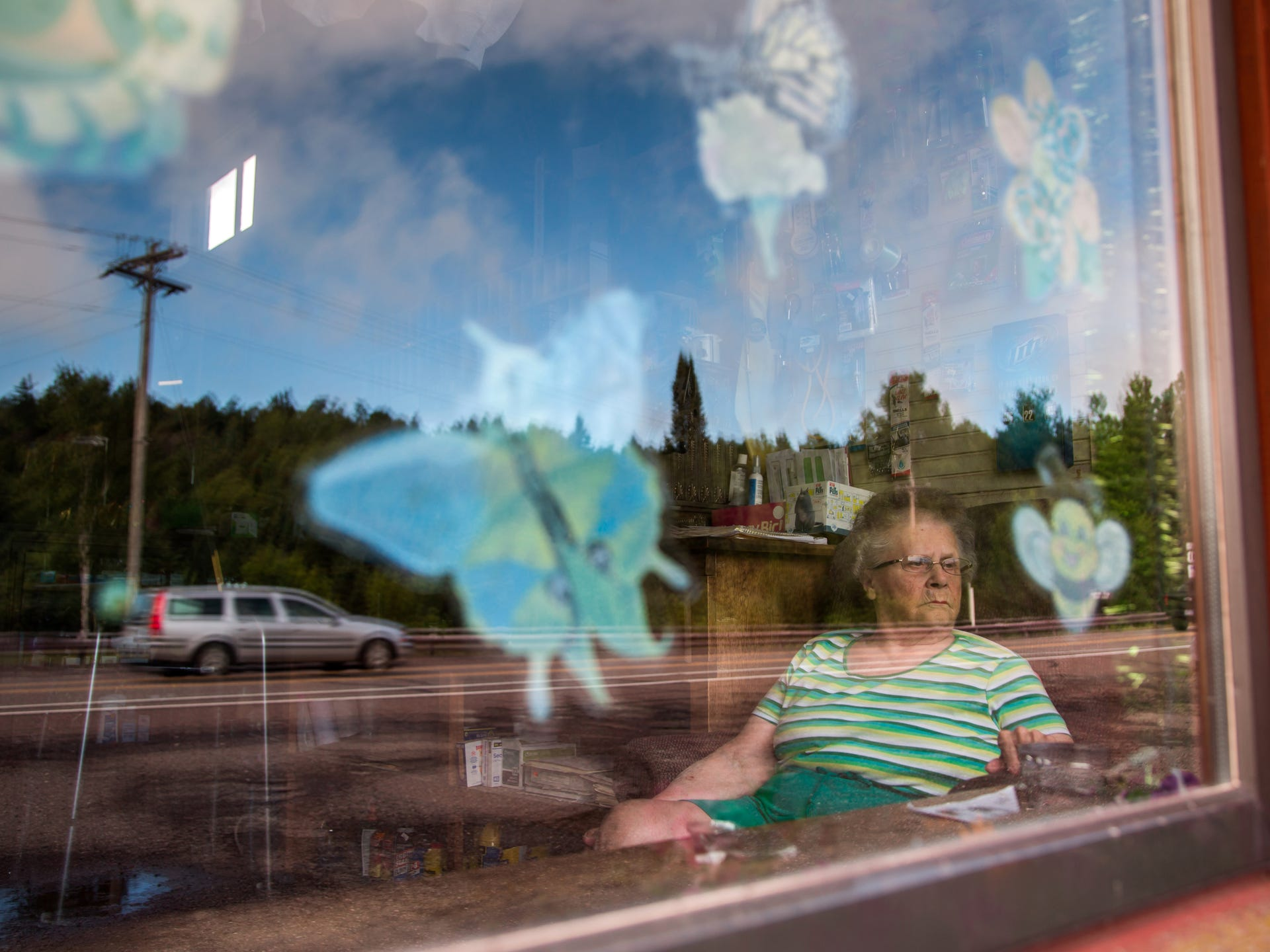 Arbutus Peterson, 84, of Phoenix watches traffic passing