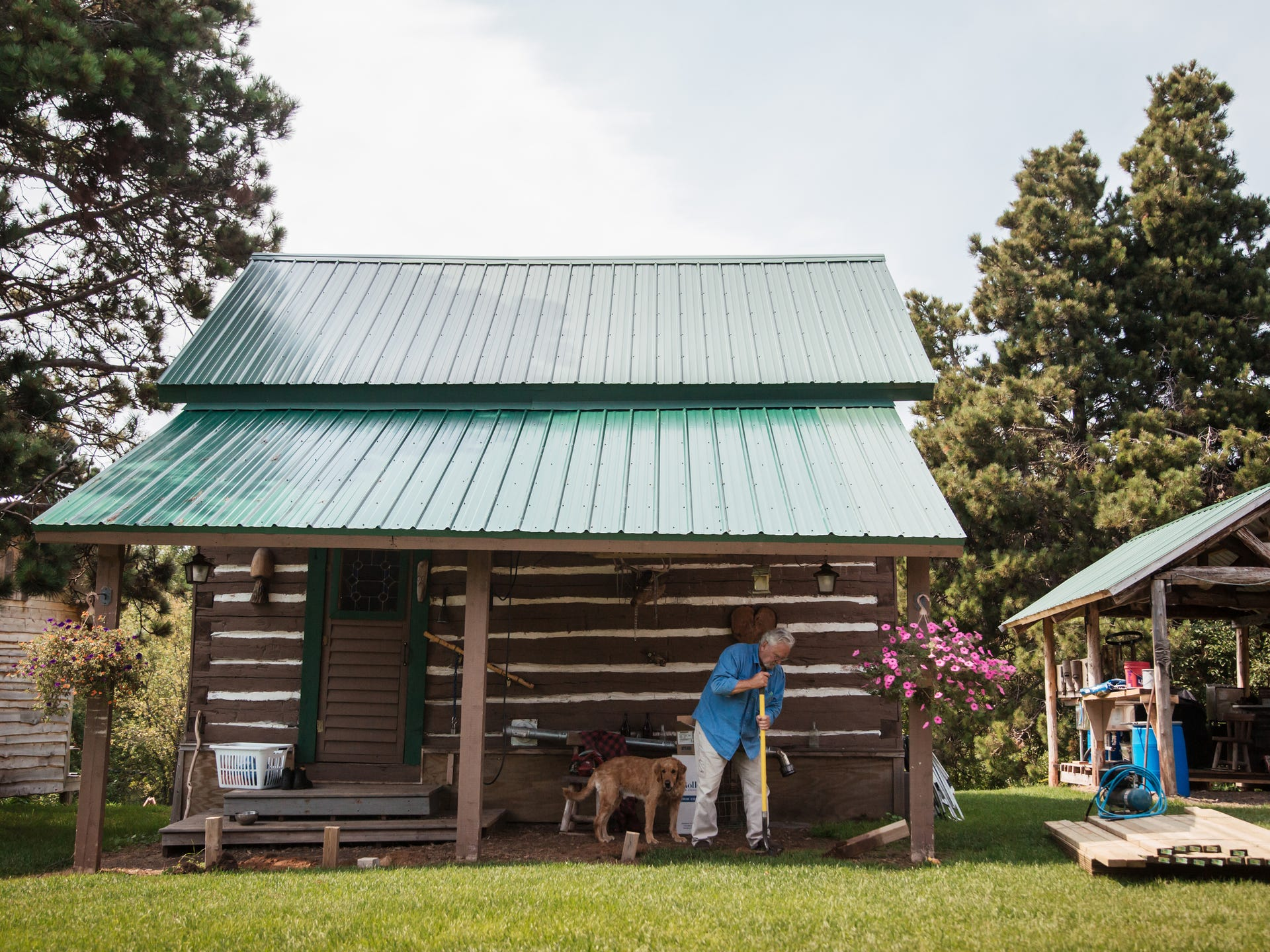 Jim Vivian, 74, does yard work at his cabin in the