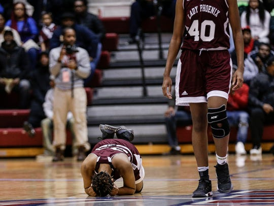 Renaissance guard Jamaria Johnson (23), left, reacts