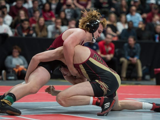 Rocky Mountain High School's Alec Hargreaves, left, placed second in 5A at 195 pounds at the state tournament last year. He's a favorite to win the 195 title this year.
