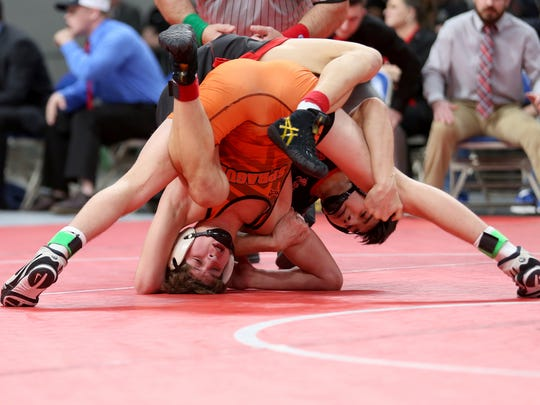 Sprague's Daniel McClung, left, and David Douglas' Anthony Cha compete in the OSAA Wrestling State Championships Class 6A final for weight 132 at Veterans Memorial Coliseum in Portland on Saturday, Feb. 17, 2018. Cha was the champion.