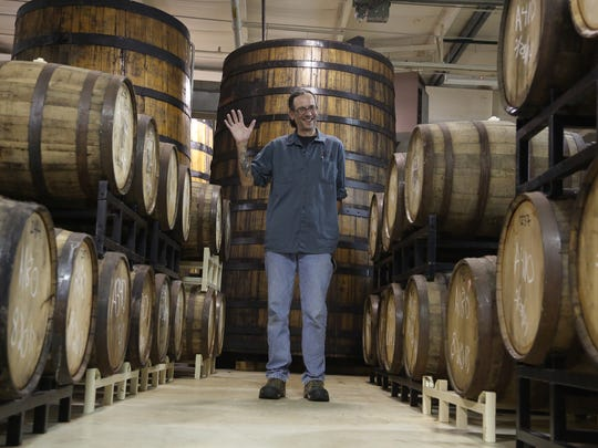 Ron Jeffries is surround by many barrels with ales inside of them at his Jolly Pumpkin brewery on Friday, April 3, 2015 inside an industrial park in Dexter, Michigan.