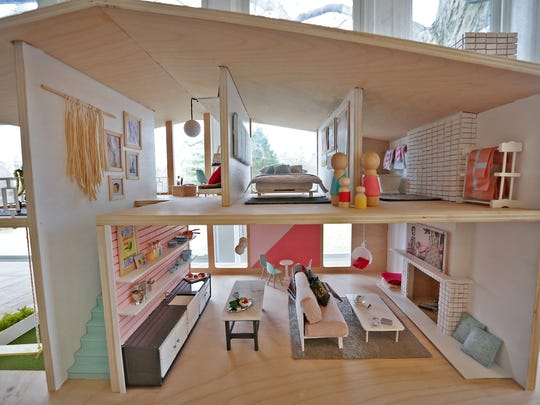 """Rooms are seen, Tuesday, Feb. 20, 2018, in the dollhouse designed by Ashley Lee, to sell in the silent auction of the Gigi's Playhouse 2018 Gala, """"I Have A Voice,"""" a benefit for Gigi's Playhouse Down syndrome achievement centers.  Liz Sutton also designed a dollhouse for sale in the charity auction."""