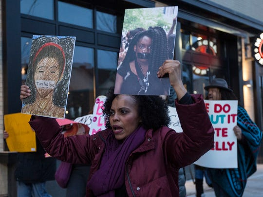 Scheherazade Tillet of Chicago, Ill., protest outside of Little Caesars Arena in Detroit before R. Kelly's concert, Wednesday, Feb. 21, 2018.