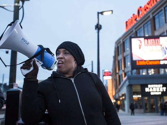 "Kalimah Johnson of Detroit, chants ""Mute R. Kelly"""