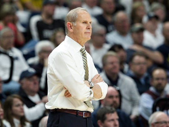 Michigan Wolverines head coach John Beilein looks on