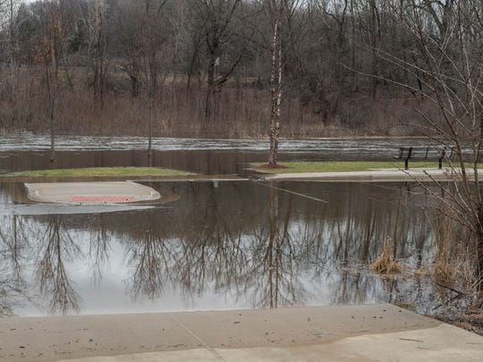 The Kalamazoo River overflowed its banks in Albion and at Historic Bridge Park in Battle Creek in February.