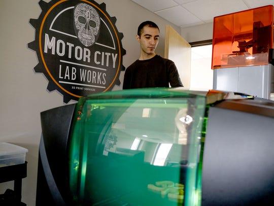 Motor City Lab Works lab technician Donovan Kachi checks