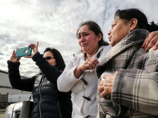 Sofia Lawrence, center, gets emotional while standing with Alma Gutierrez, right, and Elizabeth Willingham, all of Detroit, while watching the former First Latin American Baptist church being torn down. Lawrence and Willingham were both baptized at the church and attended family functions there.