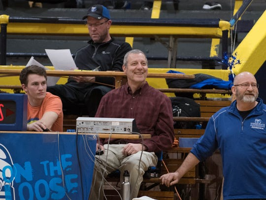 Russ Bortell (center), longtime coach and admissions recruiter at Kellogg Community College was given an on-court presentation in recognition of his 30 years at the college.