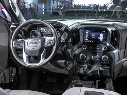 The dash on the 2019 GMC Sierra Denali pickup is seen during the reveal in Detroit on Thursday, March 1, 2018.