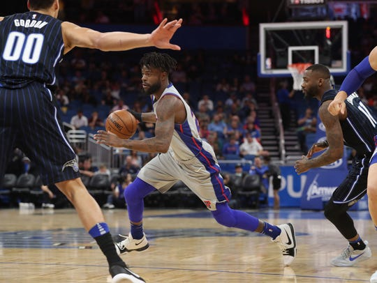 Reggie Bullock handles the ball in the first quarter in Orlando on Friday.