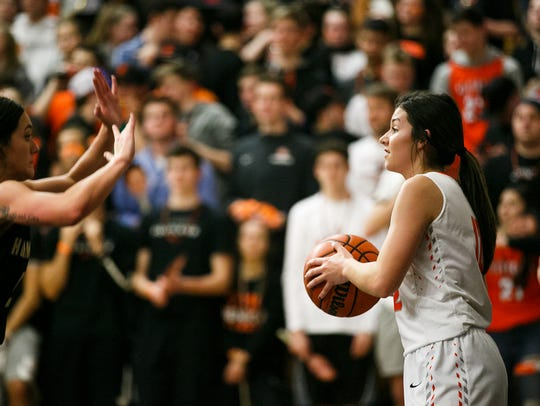 Silverton's Brooke McCarty (12) looks for an open teammate in a first-round 5A state playoff game against Hermiston on March 2, 2018 at Silverton High School. The Foxes won 40-24.
