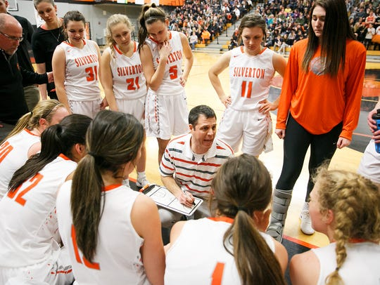 Silverton head coach Tal Wold talks with his team in a first-round 5A state playoff game against Hermiston on March 2, 2018 at Silverton High School.