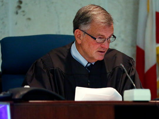 Judge Mike Carr talks to the jury during a 2015 trial