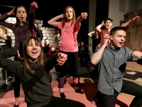 "The cast rehearses for ""Shrek the Musical"" at Regis"