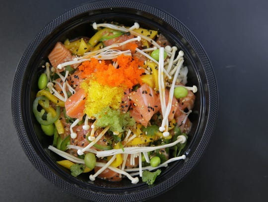 Salmon poké, made with edamame, mango, jalapeno, cilantro and chili oil, among other dishes, at Yuzu Kitchen in Manalapan.