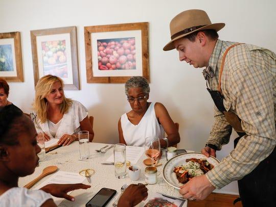 Kieron Hales, executive chef of Cornman Farms, severs