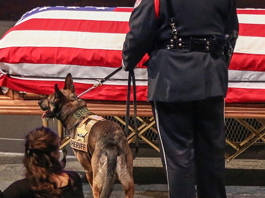 Boone County Deputy Jacob Pickett's K-9 officer Brik stands near the casket during Pickett's funeral, at Connection Pointe Christian Church in Brownsburg, Ind., Friday, March 9, 2018. Pickett was lead K-9 handler in Boone County and patrolled with Brik for more than two years.