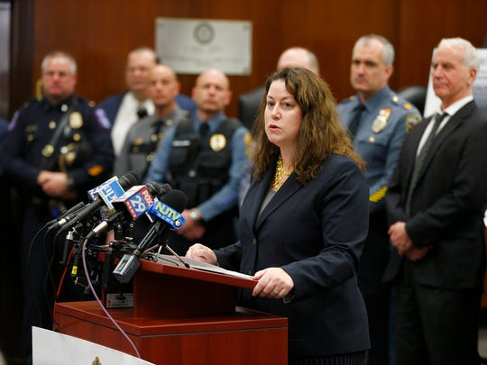 NJ Deputy Attorney General Jennifer Davenport speaks during a press conference where Ocean County Prosecutor Joseph Coronato announced a massive drug bust and seizure in Toms River, NJ, Friday, March 9, 2018.  The Jersey Shore pipeline investigation involved seven other counties, 30 law-enforcement agencies including DEA. Seizures: $900k cash 27 high-end vehicles worth $700k 90k doses (1,800 bricks) of heroin and cocaine.