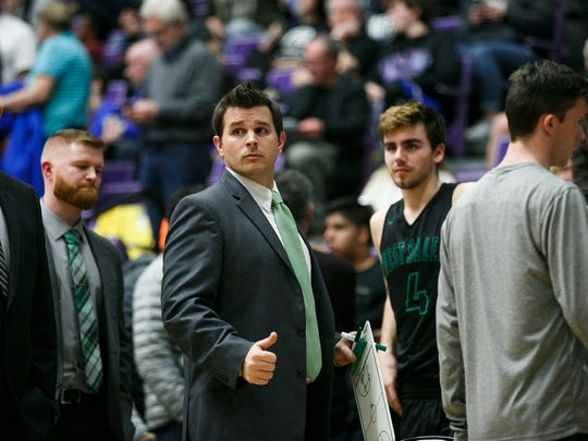 West Salem head coach Travis Myers calls players in for a huddle in a quarterfinal game against Grant on Thursday, March 8, 2018, at University of Portland. West Salem lost to Grant 72-57.