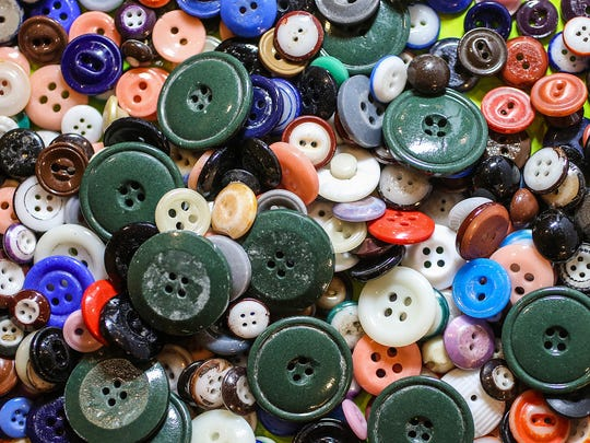 A tray of miscellaneous buttons are available for purchase on the final day of the 77th annual Indiana Button Show and Competition at the Clarion Hotel in Indianapolis, Saturday, March 10, 2018.