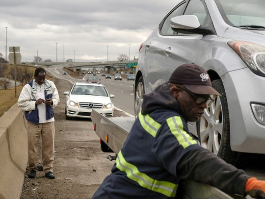 Ibrahim Mohamed of Taylor watches as his car is loaded