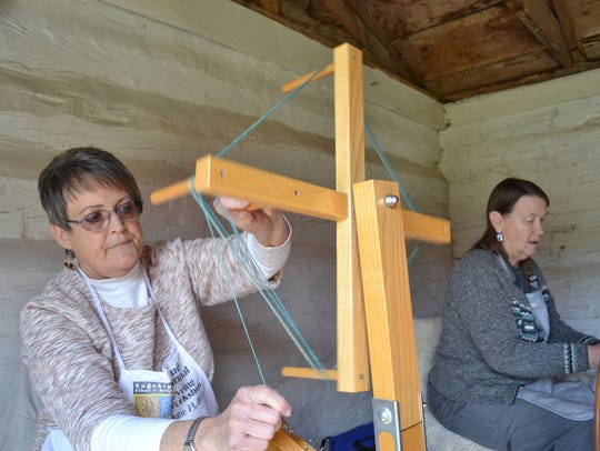 Wool is spun into yarn at Homestead State Park Museum.
