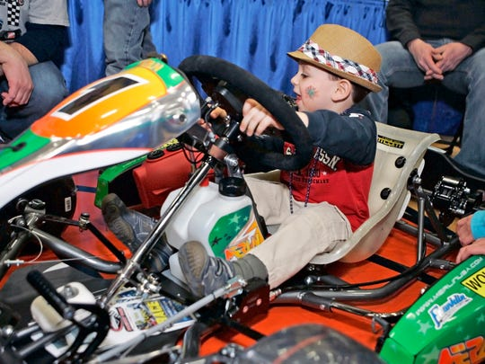 Jack Montes of Pewaukee tests a kid kart at the Badger Kart Club booth at the 2014 Lake Country Community Fest at Kettle Moraine High School. This year's event is this weekend.