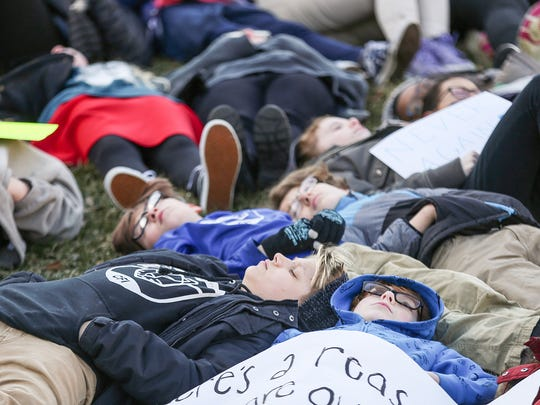 Students from the Center for Inquiry School 2 lie down for a National School Walkout demonstration at the American Legion Mall in downtown Indianapolis.