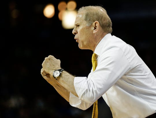 Michigan head coach John Beilein reacts to a play during