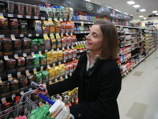 Heidi Fulk, 41, of Livonia looks for coffee while shopping