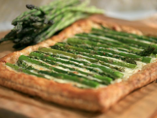 The Asparagus Fontina Tart calls for 2 cups of Fontina or Gruyere cheese.