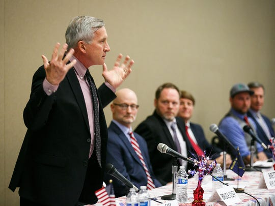 """Republican gubernatorial candidate Sam Carpenter delivers his closing remarks at a debate hosted by Oregon Women for Trump on Saturday, March 24, 2018, at the Keizer Community Center. """"There's no more crossing the aisle. We've been doing that for 30 years. We need to go in there and we need to fix it,"""" Carpenter said."""