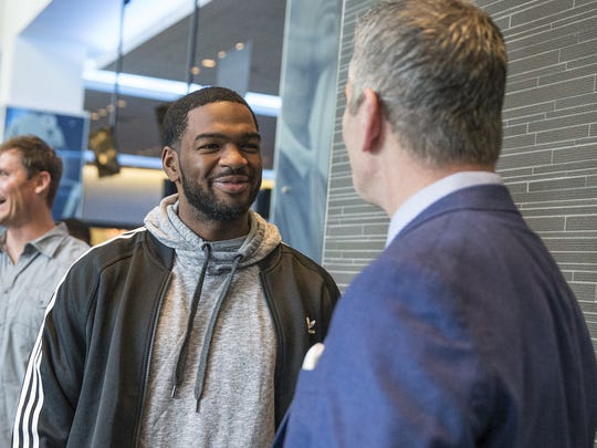 Indianapolis Colts quarterback Jacoby Brissett talks with Frank Reich after a press conference introducing Reich as head coach of the Colts, at Lucas Oil Stadium in Indianapolis, Tuesday, Feb. 13, 2018.
