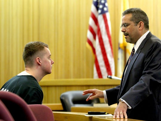 Liam McAtasney speaks with his attorney Carlos Diaz-Cobo