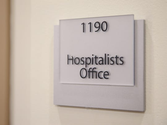 A sign for the hospitalists' office space is seen at Community Hospital South in Indianapolis, Friday, March 23, 2018. Hospitalists oversee patients' care while they are hospitalized and alternate working one week on, one week off, with no call responsibilities during time off.