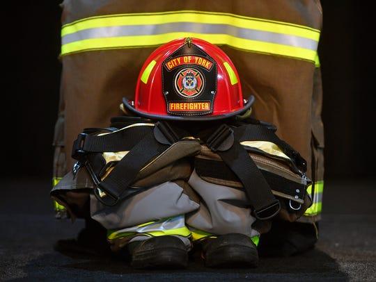 York City firefighter Ivan Flanscha's helmet and turnout
