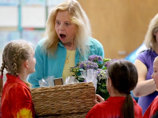 Teacher Maureen Foelkl is surprised with a basket of chocolates and flowers as a thank you gift from her students during an awards ceremony at Chapman Hill Elementary School in West Salem on Friday, April 8, 2016. The students were regional winners of the Toshiba and National Science Teachers Association (NSTA) ExploraVision program with their Triple E water bottle. The water bottle is edible, electrolyte balanced and eco-friendly.