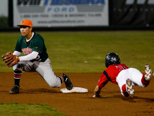 Porterville's Daniel Perez bobbles the ball trying to make the tag against Tulare Western's Nathan Marroquin during 34th annual PRO-PT Tulare/Visalia Baseball Invitational upper-division championship game. Porterville defeated Tulare Western 5-4 Wednesday night at Visalia Rawhide's Recreation Park.