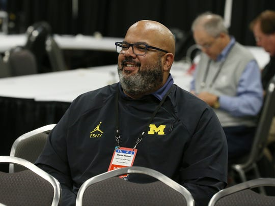 Michigan athletic director Warde Manuel listens in during a news conference on Sunday, April 1, 2018, at the Alamodome in San Antonio.