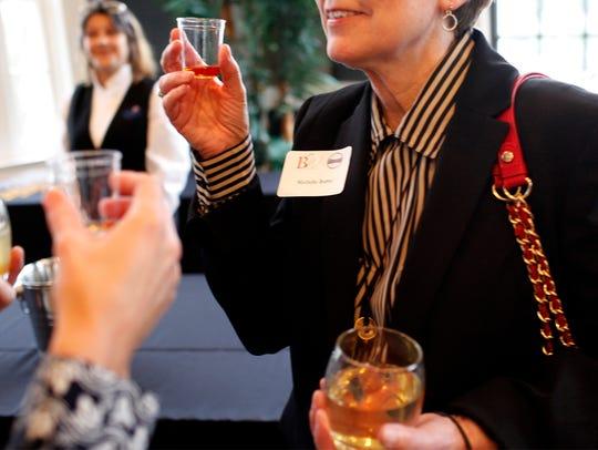 Michelle Burtel samples bourbon during a blind tasting.